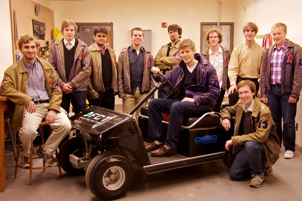 QFCT team executive, with our emissions-free Mini-Cart.