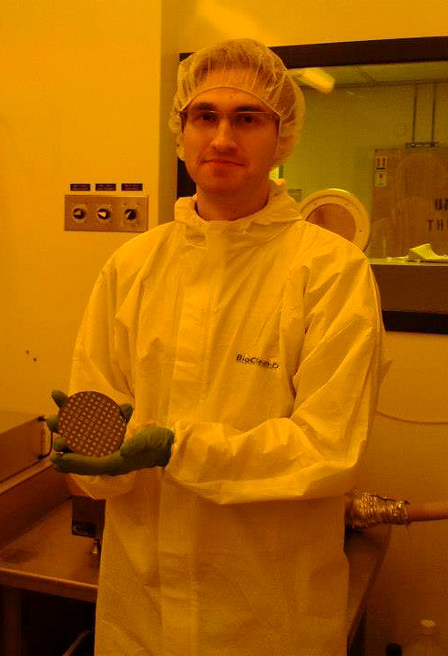 Holding a fresh batch of prototype chips in the TNFC cleanroom.
